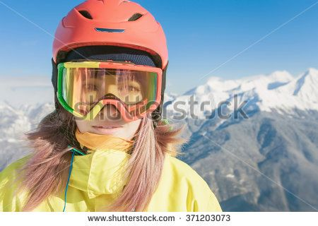 Snowboard. Female snowboarder or skier on the background of high snow-capped Alps in Swiss