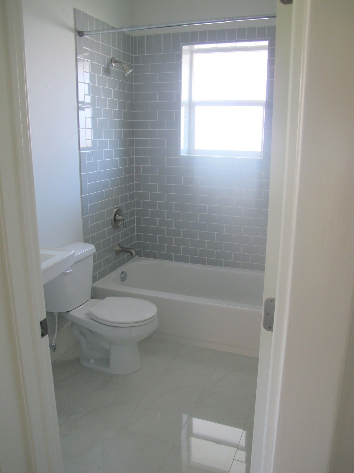 The subway tile is the desert gray subway from dal tile for Grey subway tile shower