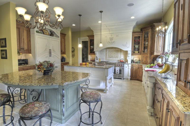 Nestled In Lancaster County This French Country Kitchen Boasts 2 Islands A Large Hood W French Country Kitchens Country Kitchen Designs Simple Kitchen Remodel