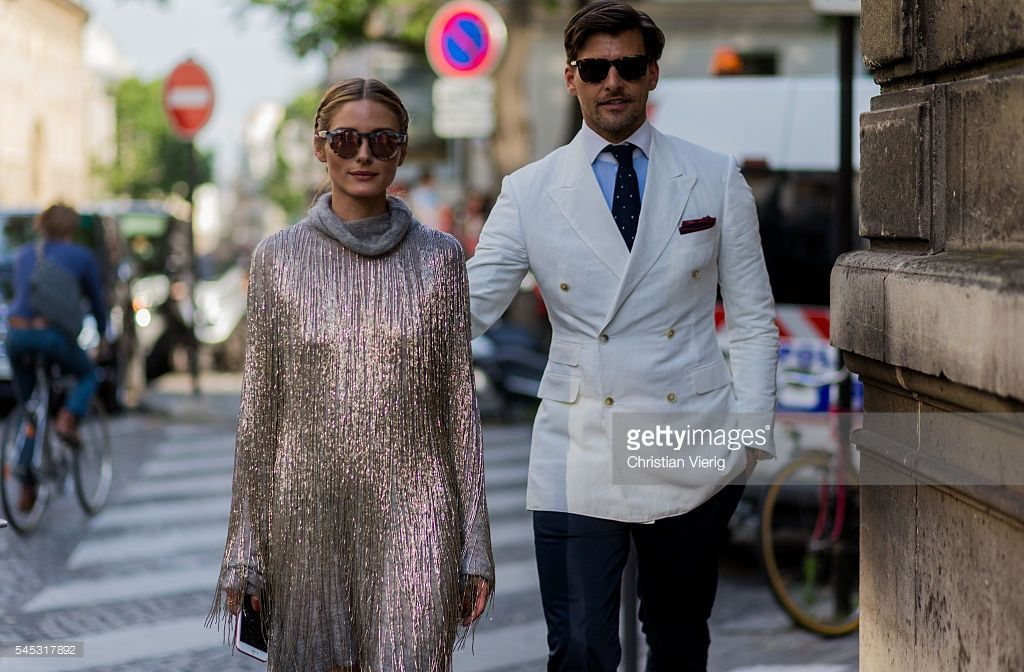 Olivia Palermo wearing a silver dress and Johannes Huebl outside Valentino during Paris Fashion Week Haute Couture F/W 2016/2017 on July 6, 2016 in Paris, France.