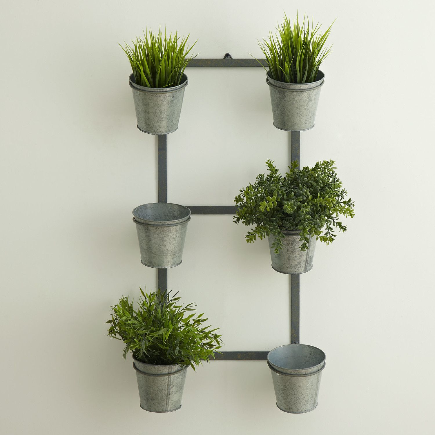 Galvanized wall planter reminds me of