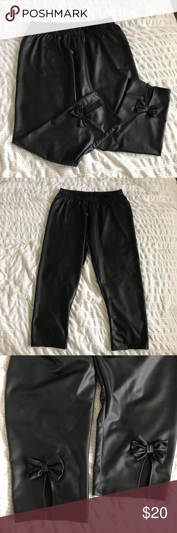 51f6c8bd628f6a Torrid Faux Leather Bow Back Leggings Faux Leather Bow Back Leggings Never  worn! torrid Pants Leggings