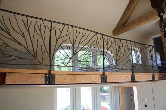 The stair railings were based around abstract tree ...