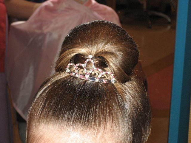 Little girl updo hairstyle from Disney's Bibbidi Bobbidi Boutique