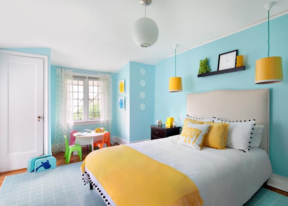 Yellow Hanging Lights And Bed Linens Pop Against Bright Blue Walls In This Contemporary Kid S Room In The Corner Multicolored Chairs Surround A Sma Room Colors