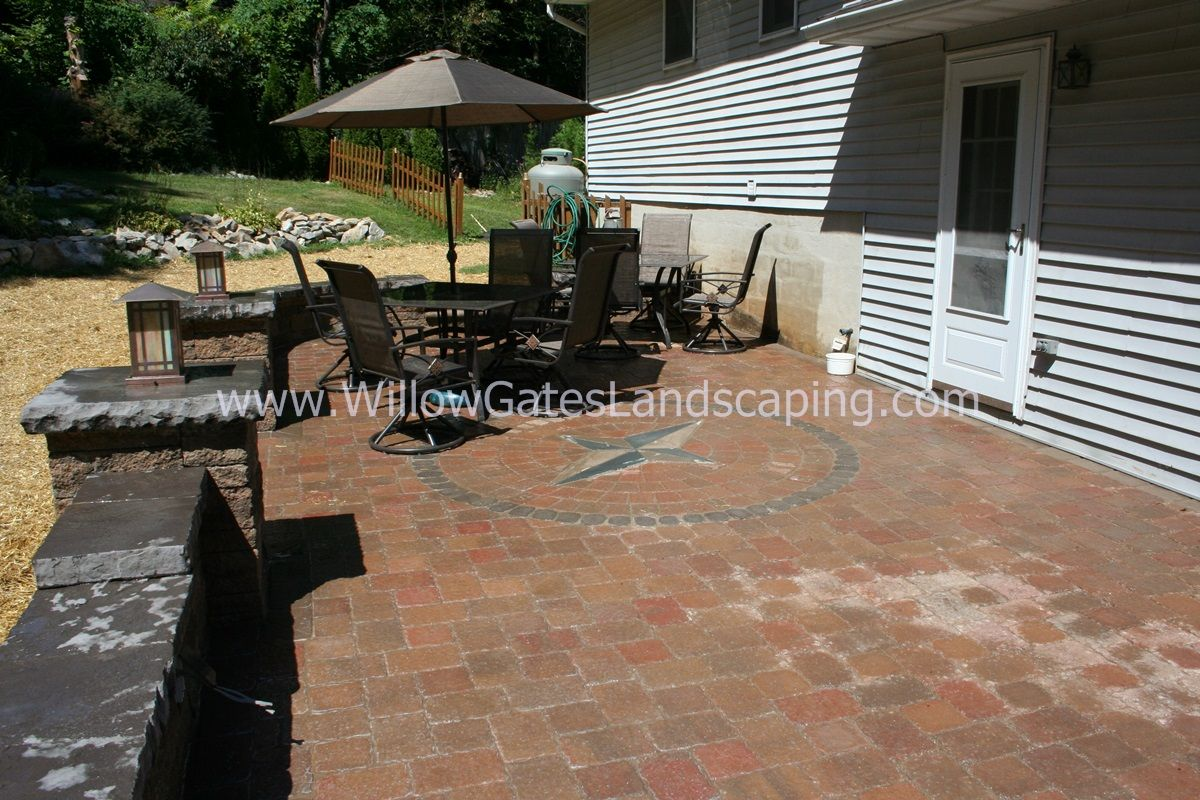 Paver Patio With Techo Bloc Mini Creta Walls U0026 Pillars, Compass Rose Inlay,