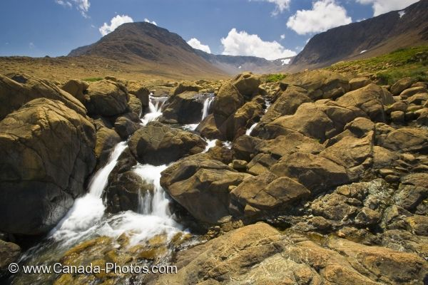 Picture of a waterfall as it rushes over the cliffs in Tablelands in Gros Morne National Park in Newfoundland Labrador.