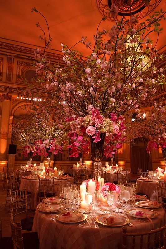Lovely Pink Cherry Branches and peonies against golden lighting at Plaza.  angela + marc wedding by Brian Dorsey photography.
