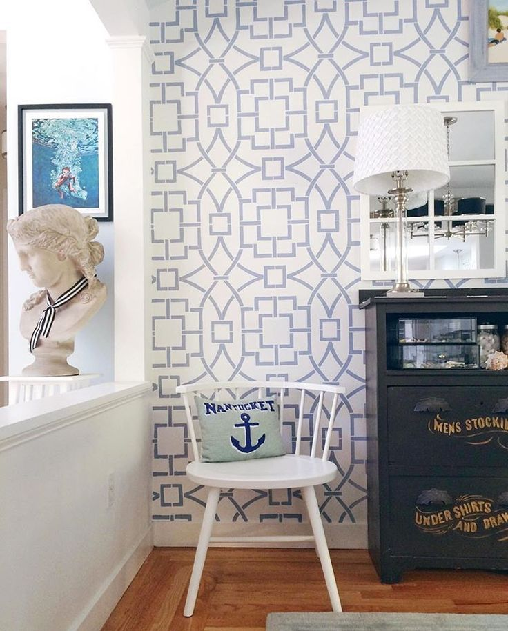 A blue and white stenciled accent wall using a large wall pattern, the Tea House Trellis Allover Stencil, from Cutting Edge Stencils. http://www.cuttingedgestencils.com/tea-house-trellis-allover-stencil-pattern.html