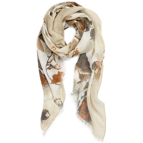 Painterly floral patterns lend modern sophistication to a soft, ribbed scarf trimmed with delicateeyelash fringe.    Brand: MODENA.  Style Name: Modena Floral…