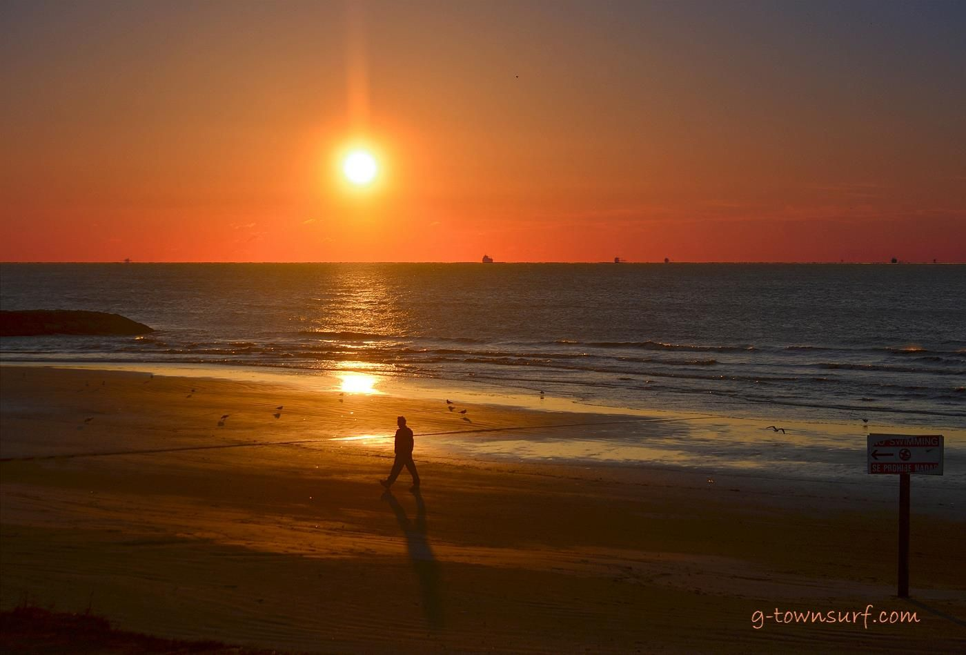 A quiet sunrise stroll on the beach in Galveston, Texas