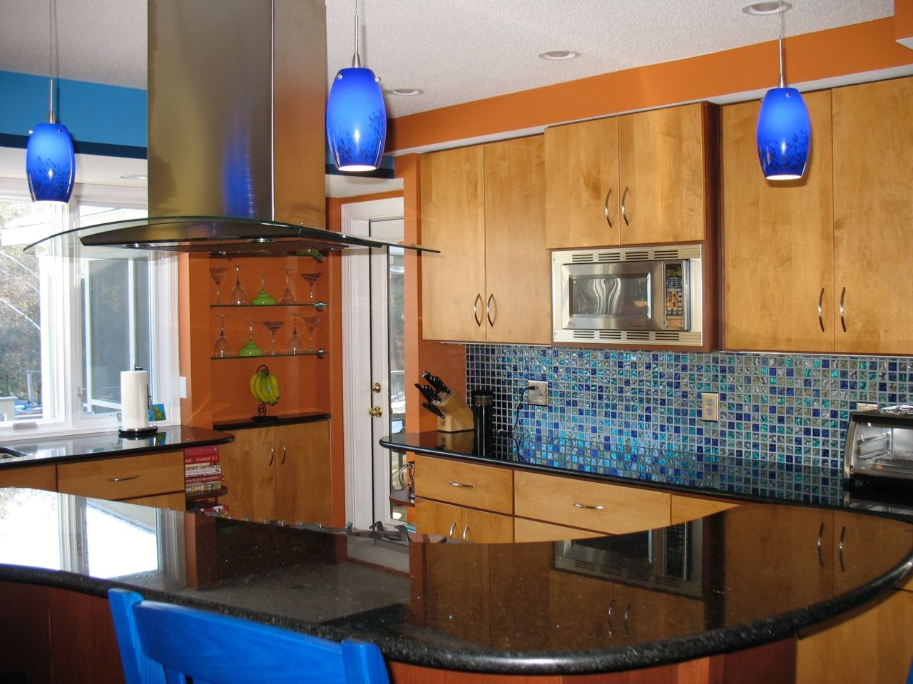 Royal Blue Barstools And Glass Pendant Lights Punctuate
