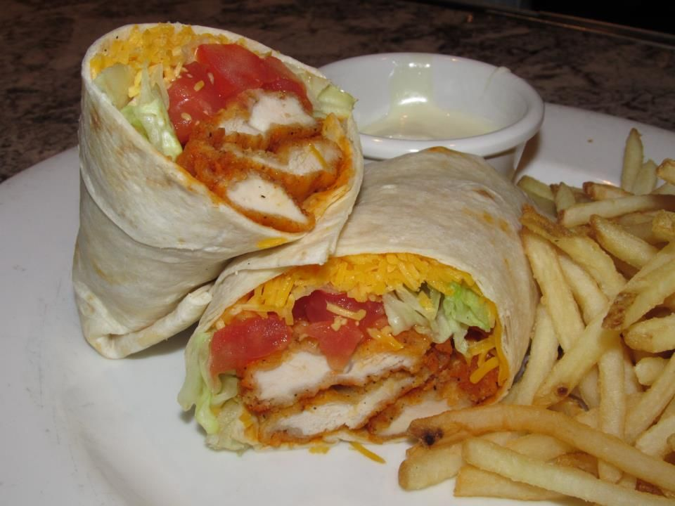 Frankie Bones Buffalo Chicken Wrap Crispy Fried Chicken Fingers Tossed In Buffalo Hot Sauce Wrapped In A Flour Torti Crispy Fried Chicken Yummy Wraps Food