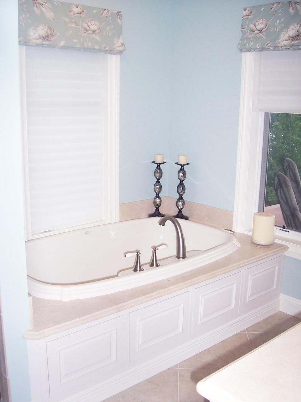 Master bedroom with jacuzzi tub  A marble deck and builtin wood base with decorative molding turn