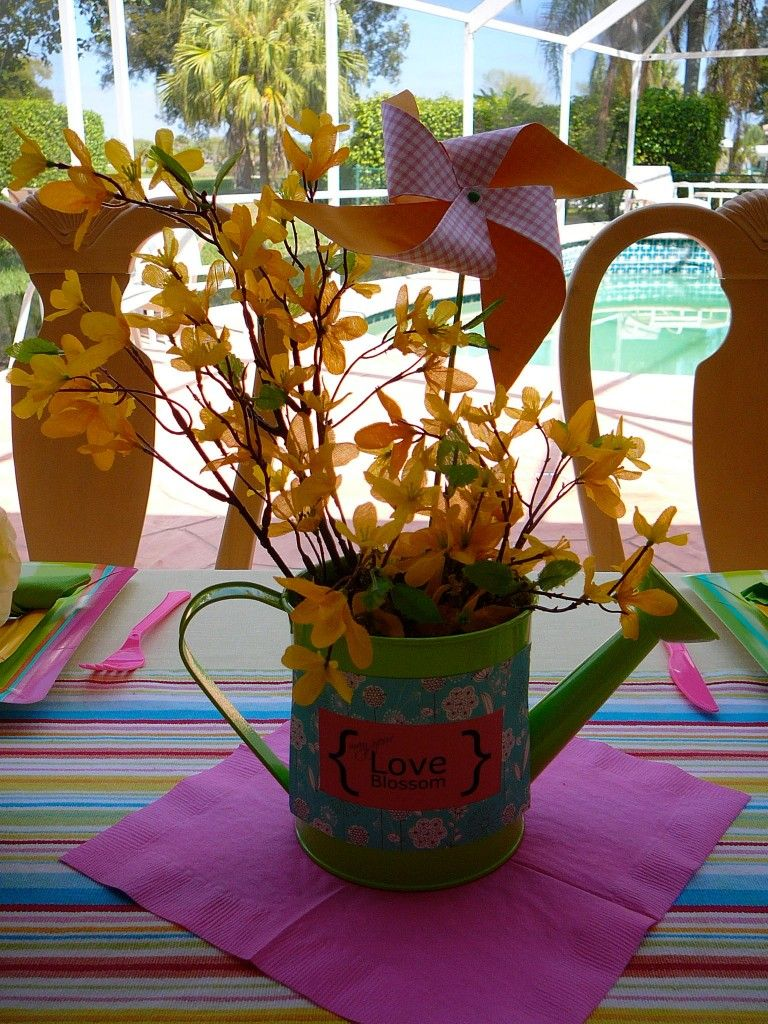 @Candace Kozlowski of Rock Candie Designs created this watering can centerpiece. To order  please visit www.rockcandiedesigns.com