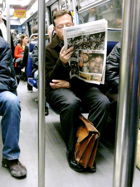 Metro Paris, 5 november, a white man reading the news about the first black man becoming president of the United States by oliver.peel, via Flickr