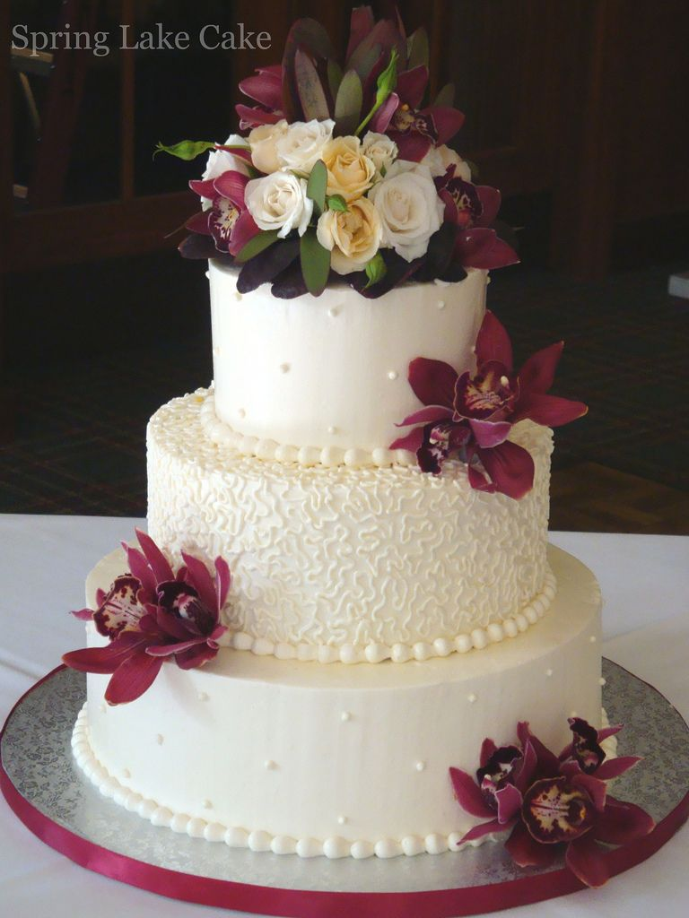 For a Fall wedding.  Iced in swiss meringue with fresh flowers.