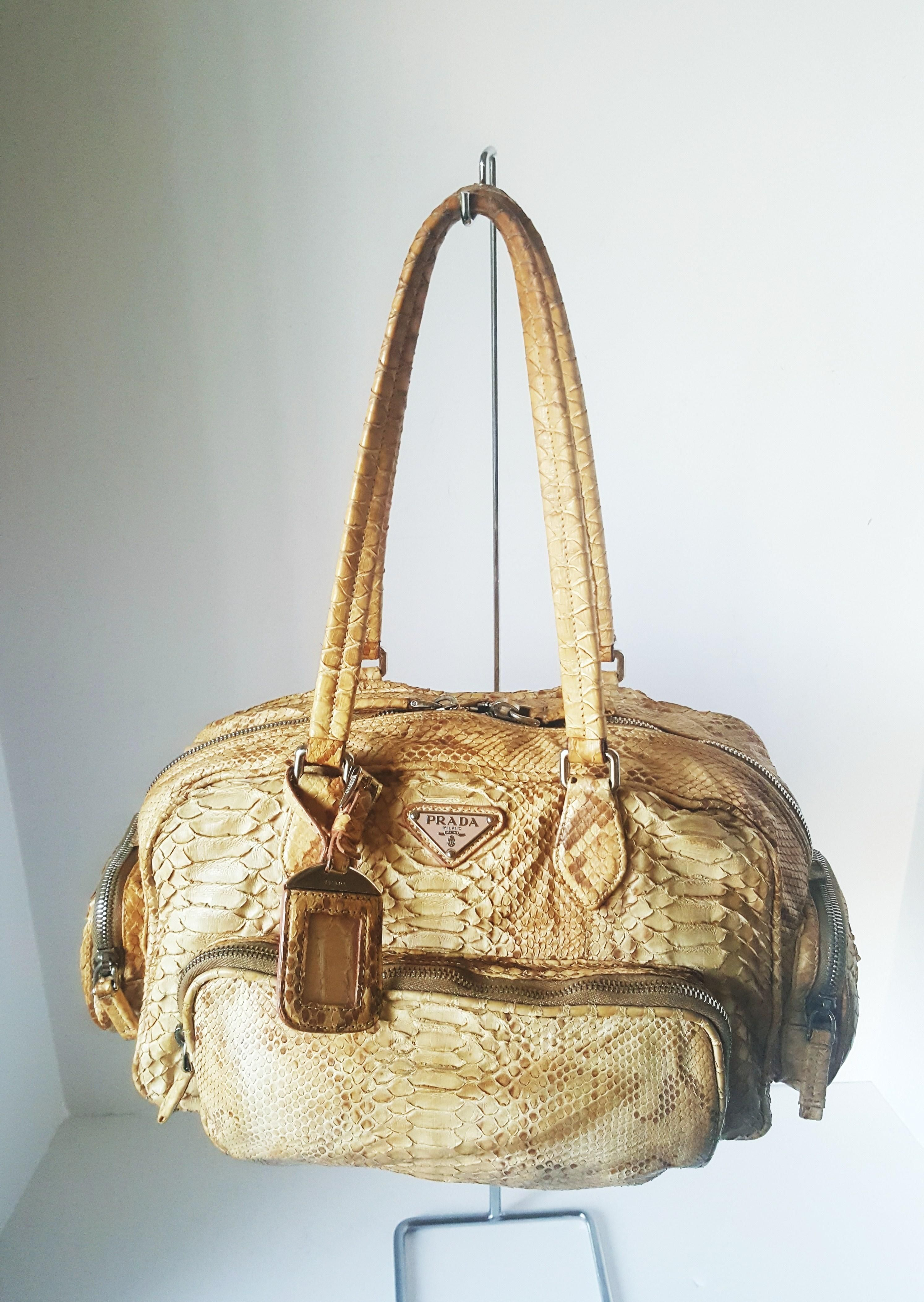 Save 66% on the Prada Limited Edition Tan Python Leather Tan Beige Satchel!  This satchel is a top 10 member favorite on Tradesy. f661c98b46e2e
