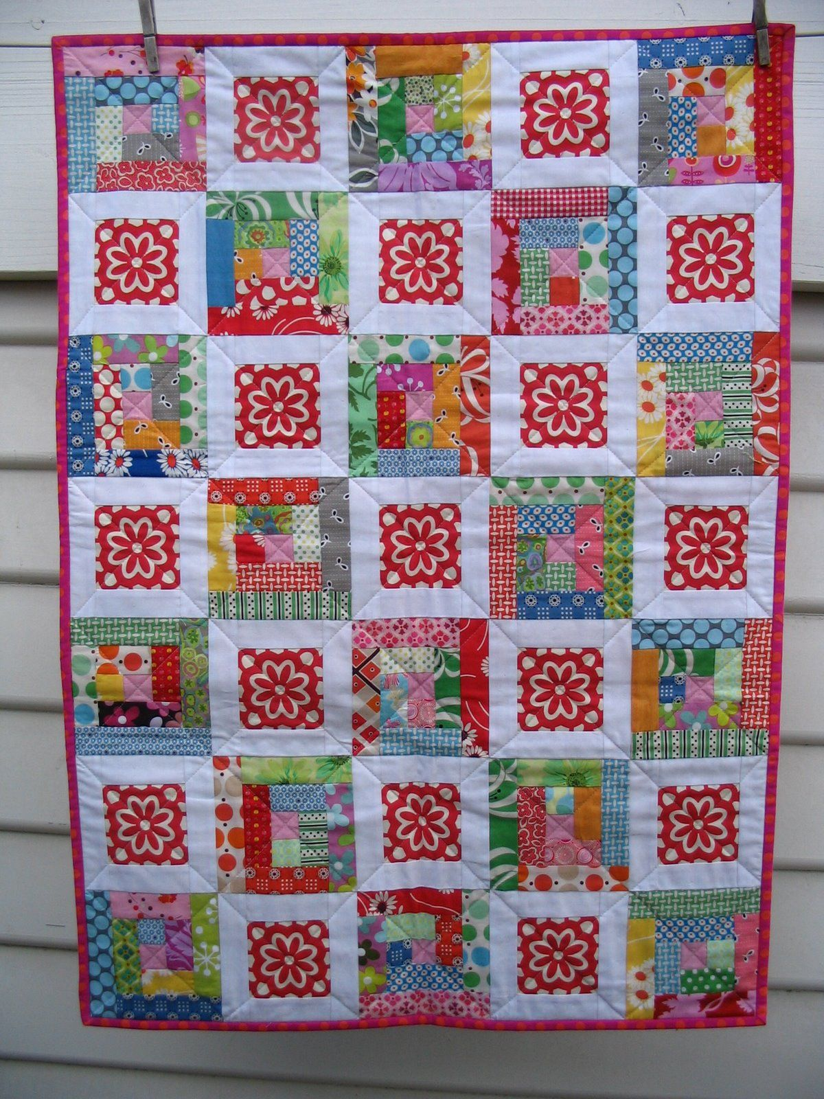Baby Quilt from Red Pepper Quilts - adorable!  Fun to use a fabric with a larger motif for the centers.