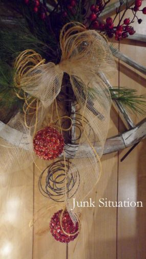 How about Christmas wreath from a wagon wheel!
