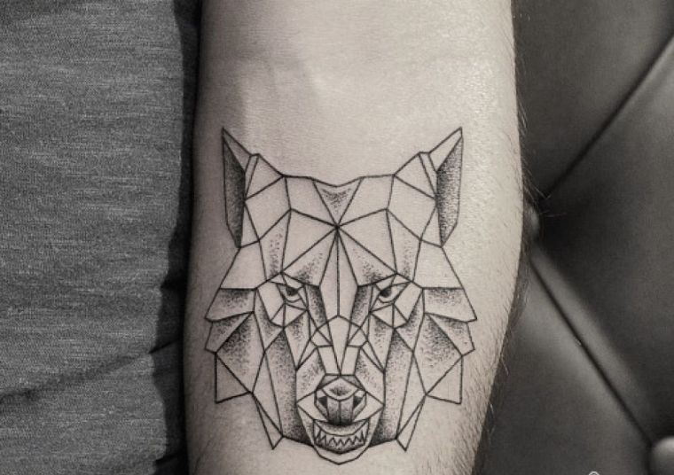 wolf tattoo and wolf s head models and meaning in. Black Bedroom Furniture Sets. Home Design Ideas