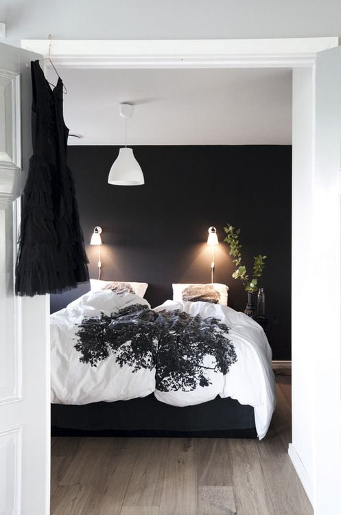 Stylish #bedroom in #black and #white with #patterned #blanket