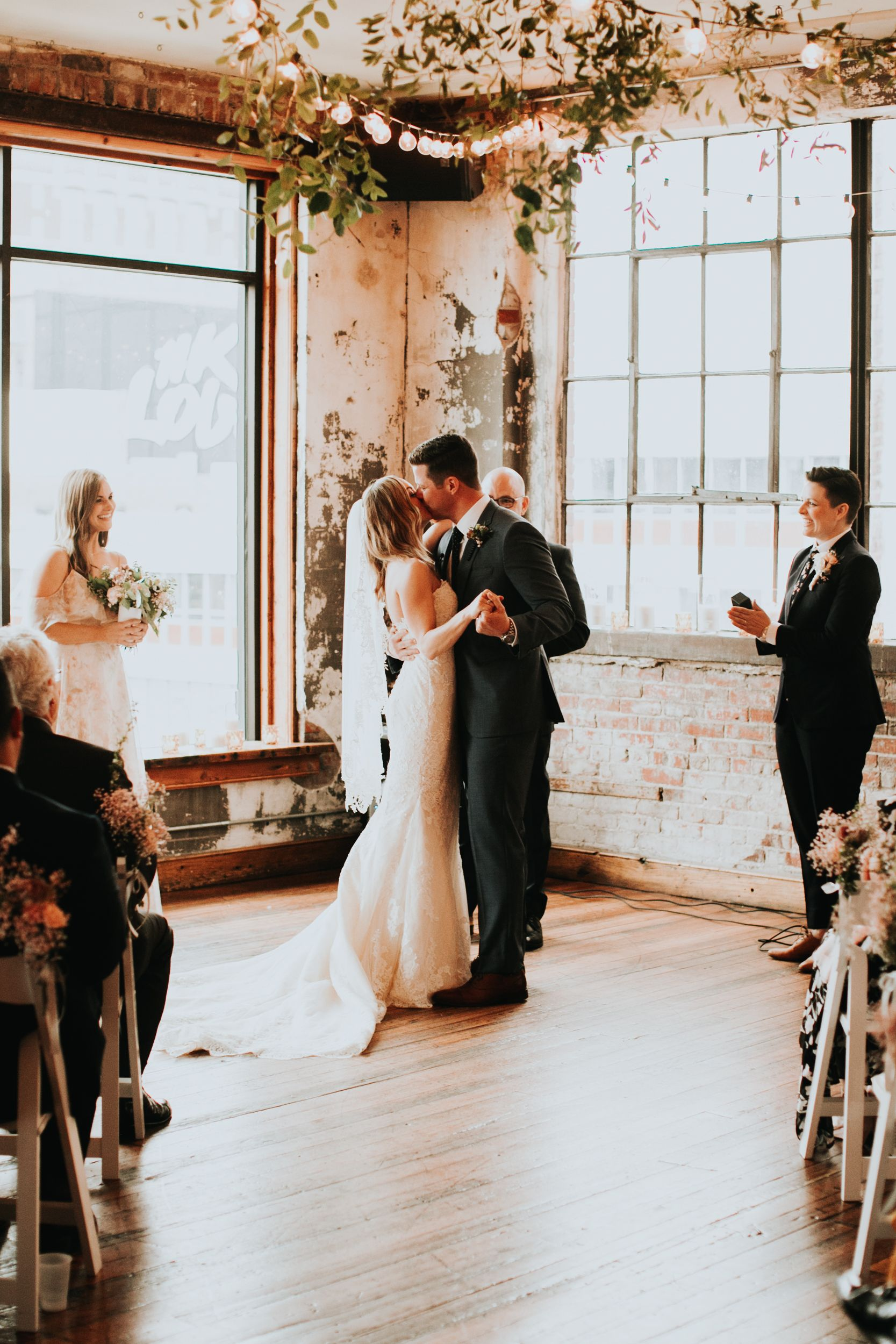 Britt And Scott S Simple Kansas City Wedding At The Bride And The Bauer The Bold Americana Kansas City Wedding Pronovias Wedding Dress Industrial Urban Wedding