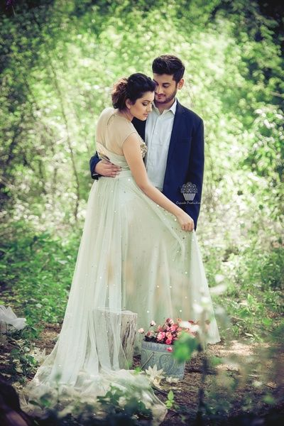 Pre Wedding Shoot Candid In A Natural Outdoor Set Up Wedmegood Bride White Fairytale Gown And Groom Blue Suit