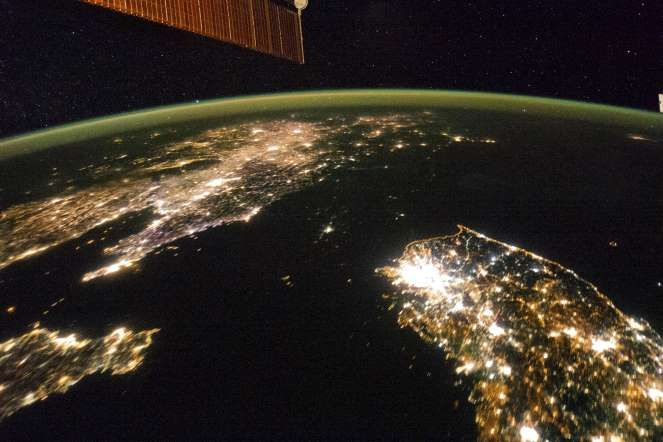 International Space Station, Earth Orbit - NASA- A NASA image released on February 24 shows a photo taken by the crew aboard the International Space Station (ISS) of the night view of the Korean Peninsula. North Korea in the middle is almost completely dark compared to neighbouring South Korea (bottom right) and China (top left).