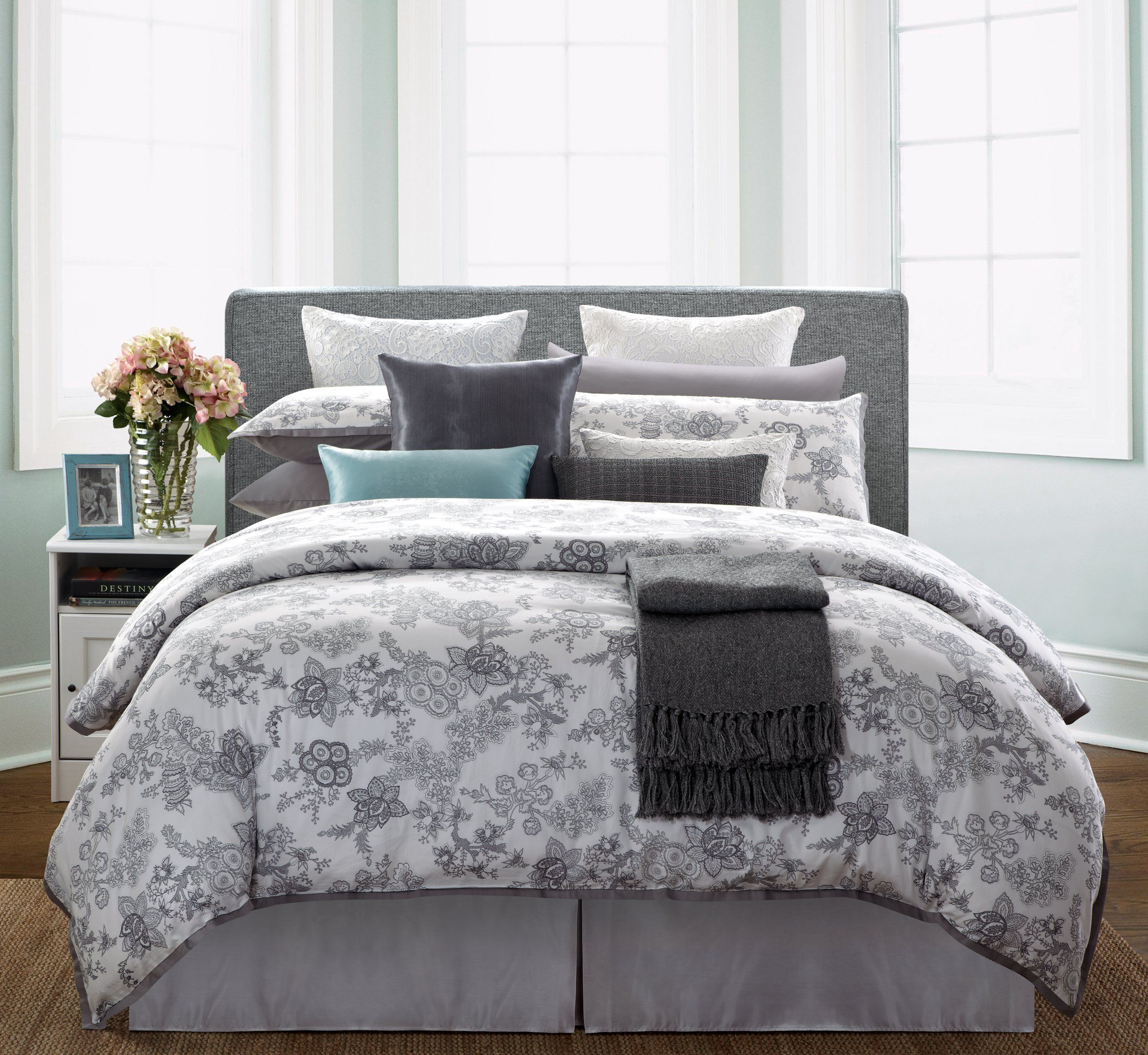 gray bed skirt. upholstered headboard, accent colors