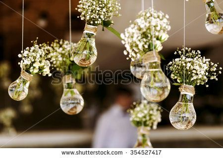 Original Wedding Floral Decoration In The Form Of Mini Vases And Bouquets  Of Flowers Hanging From The Ceiling