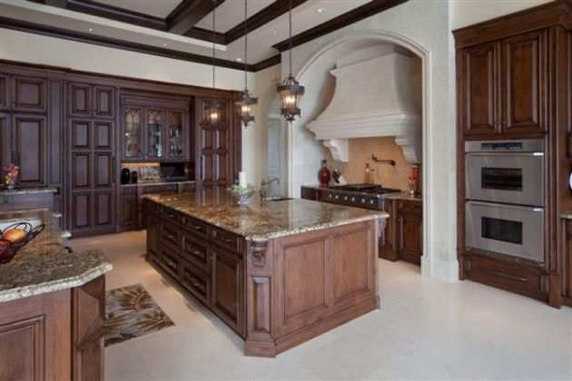 French Classy Kitchens | definitely one of my favorites.  We have different floor space so maybe a large island without another level of countertop/ cabinetry.