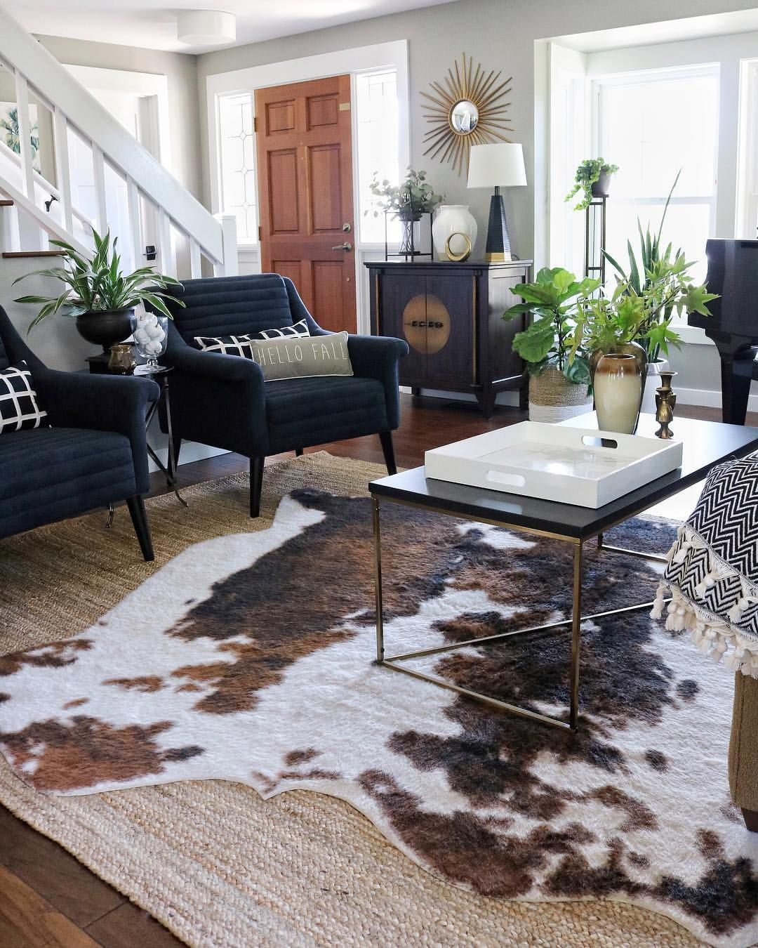 Fall Living Room With Navy Blue Chairs Layered Jute Faux Cowhide Rug Target Coffee Ta Rugs In Living Room Farm House Living Room Layered Rugs Living Room