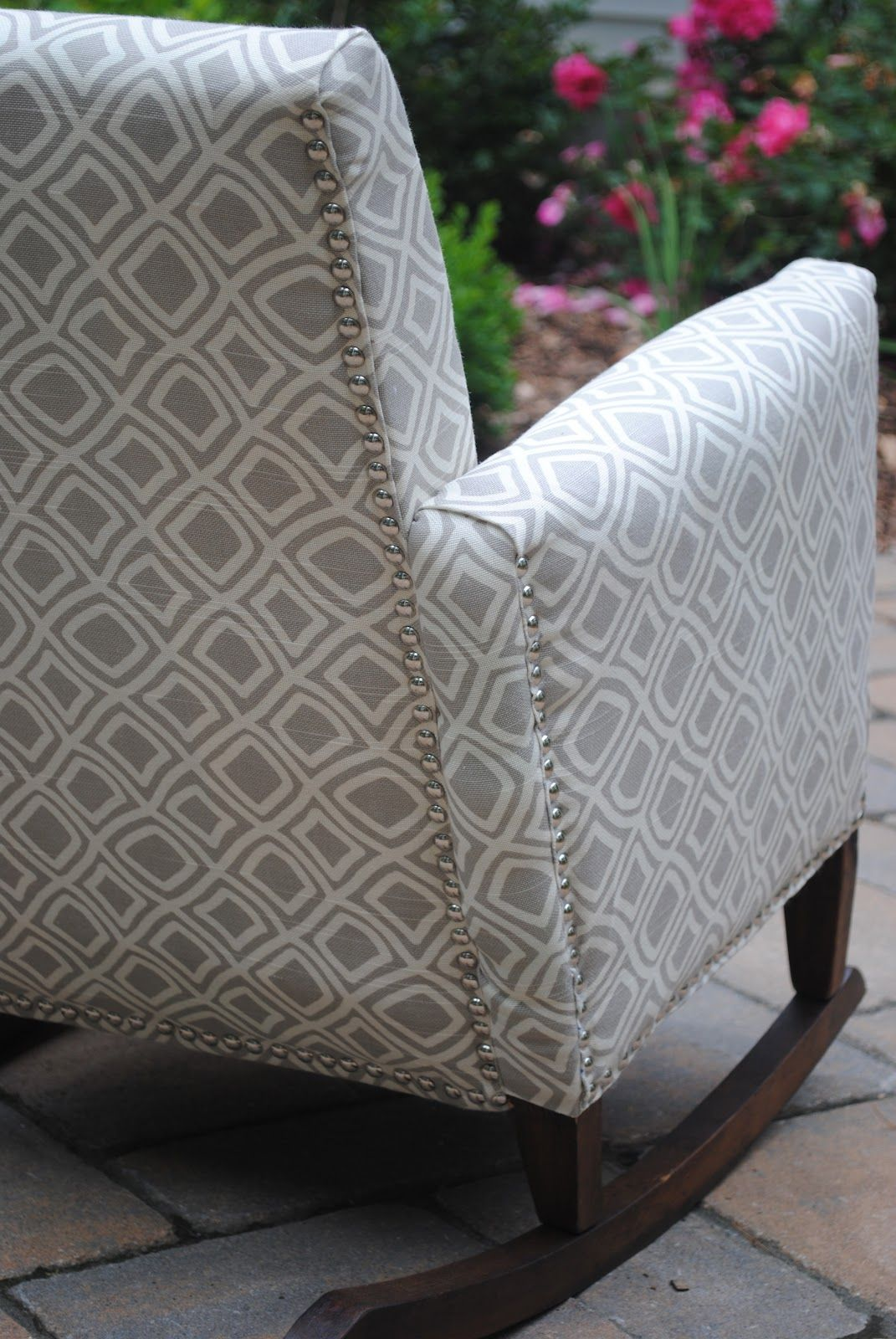 Nailhead detail on child's upholstered rocking chair