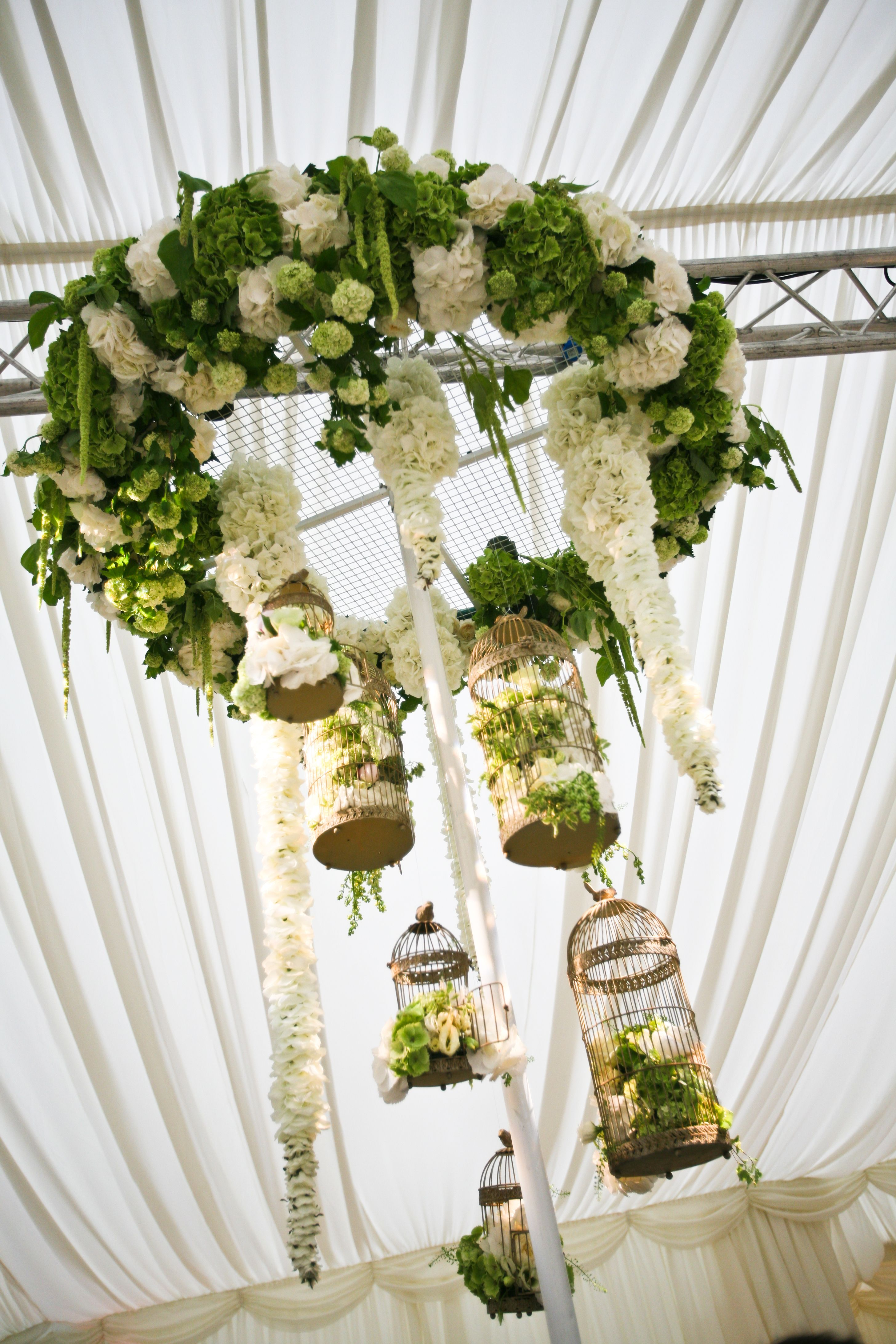 stunning white and green floral chandelier  vintage birdcages  hydrangeas an roses