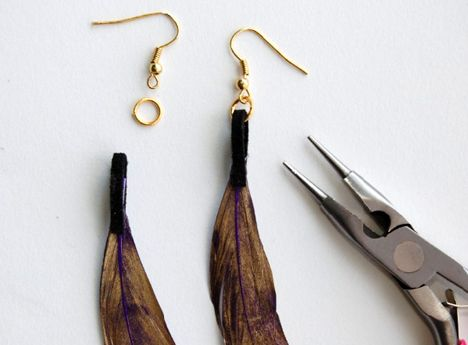 Painted feather earrings.