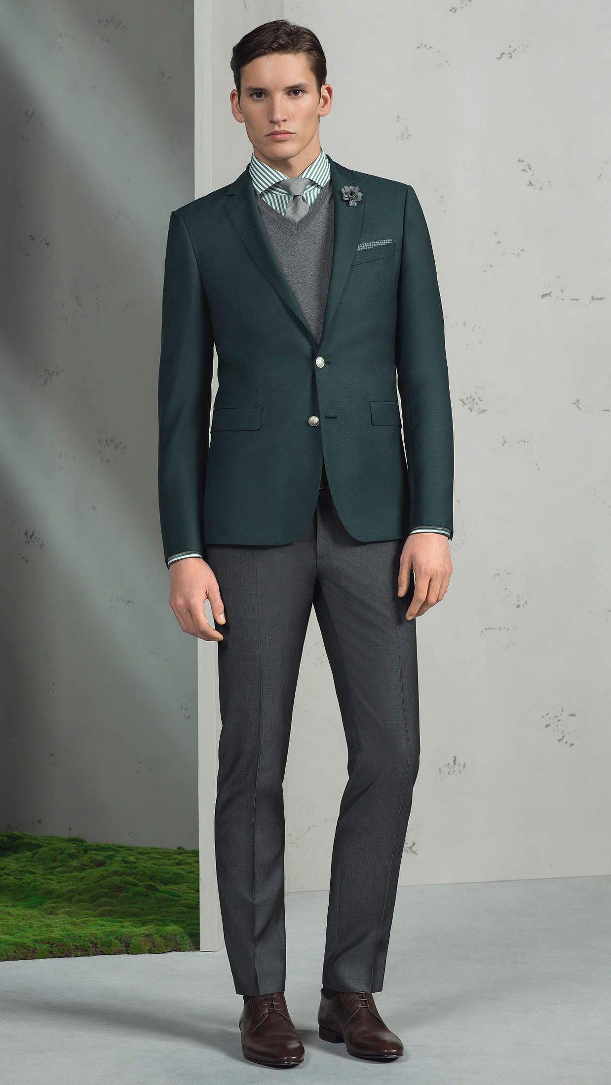 A Modern Mans Sophisticated Closet Should Always Include Such Stylish Essentials As Hunter Green Suit Jacket And Charcoal Dress Pants