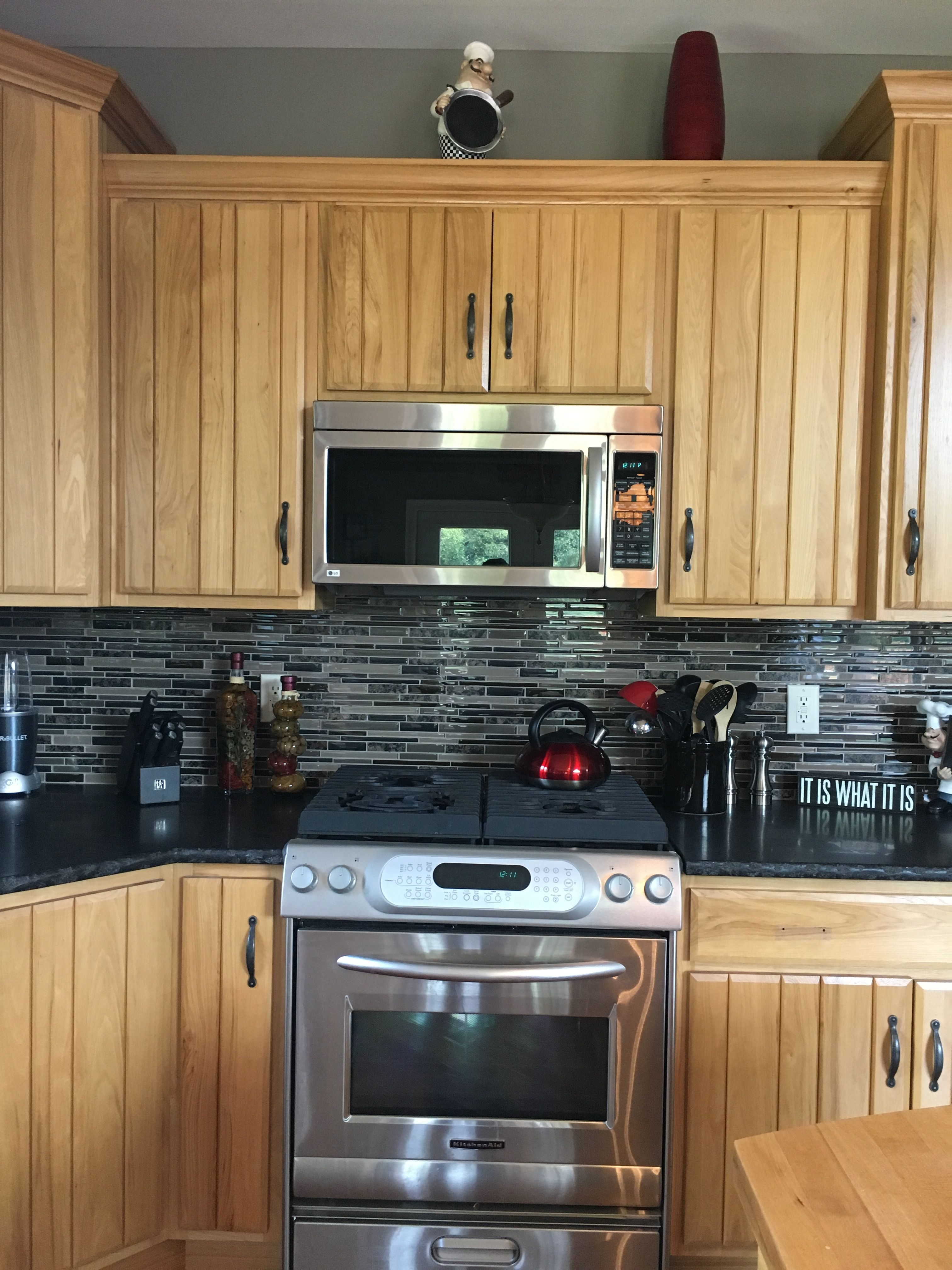 My new backsplash and paint in the kitchen. Loving it ...