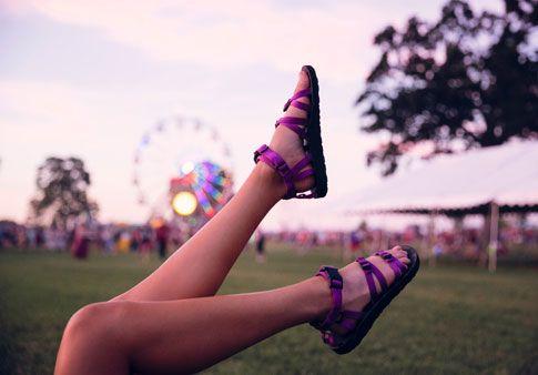 6ea6e78b7816 Woman wearing Teva Alps kicking her feet in air near festival ...