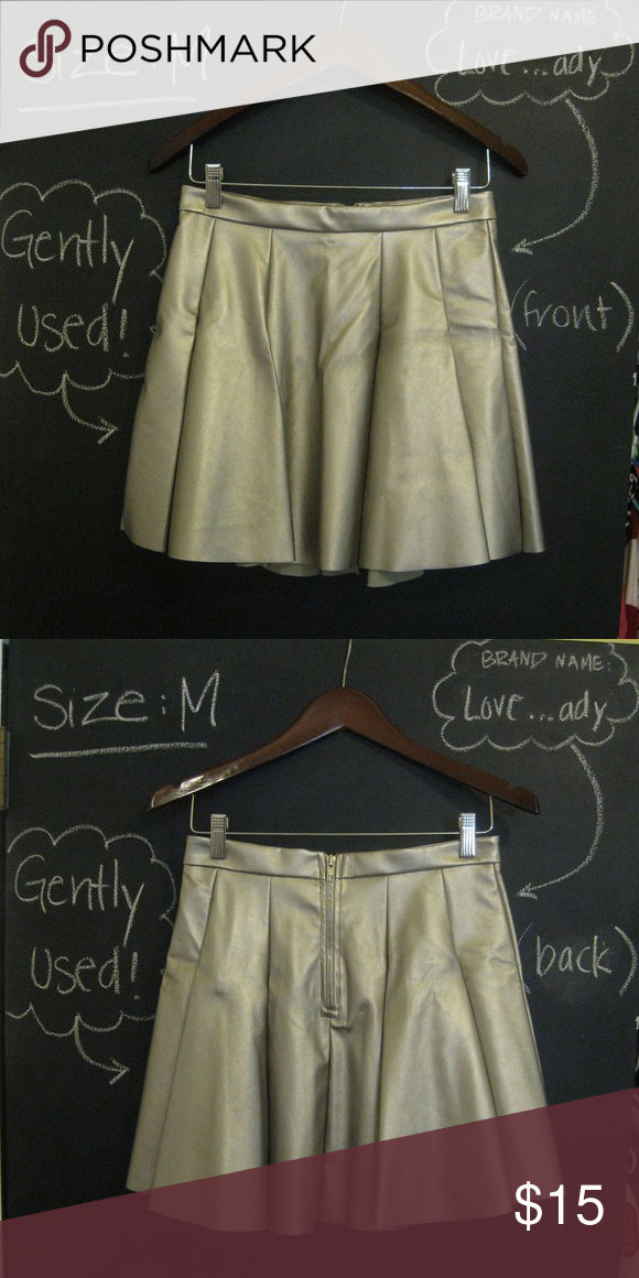 Pleated metallic fake-leather skirt Metallic skirt (has both shades of silver and gold), size: M, reaches mid thigh (I'm 5'2), great condition- I only wore it twice! love...ady Skirts Mini