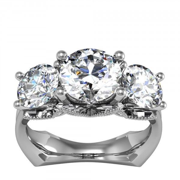 This three stone engagement ring maximizes both brilliance and comfort. The three Contemporary Nexus Diamonds™ are lifted into the light on simple straight prongs that seem to grow from the romantic intersecting hearts profile design. The bowed Euro style band sits nearly flush against your finger, making it exceptionally comfortable, and the squared off shank prevents the ring from slipping sideways.  Center Stone: 1.28 carat Round Brilliant cut Nexus Diamond, 2.88 total carat weight…