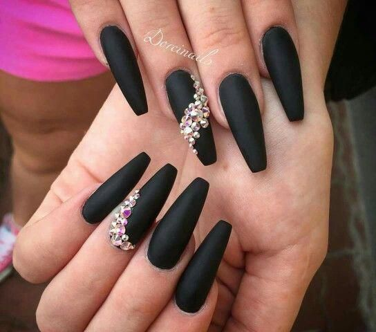 Black Matte With A Touch Of Bejeweled On The Ring Finger Is A Nice Touch For Catching Your Eye Acrylicna Black Acrylic Nails Coffin Nails Matte Trendy Nails