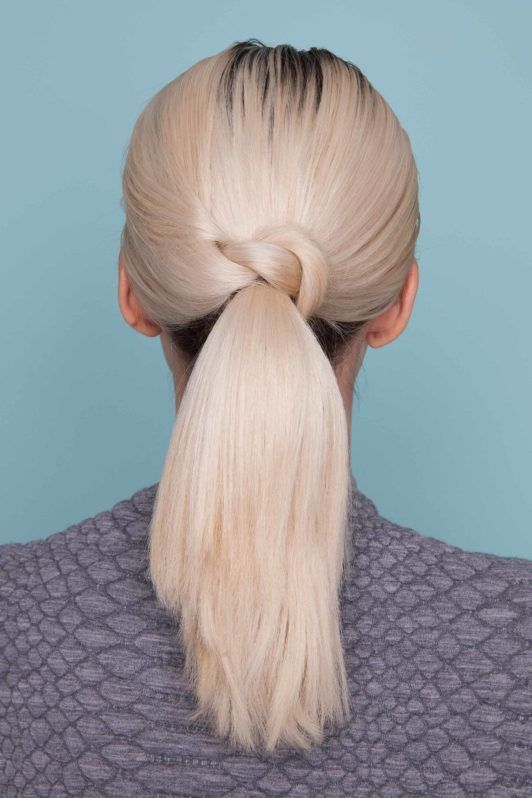 Looking for a new way to wear your everyday ponytail. Learn how to create a single knot ponytail hairstyle in just a few minutes. | All Things Hair - From hair experts at Unilever