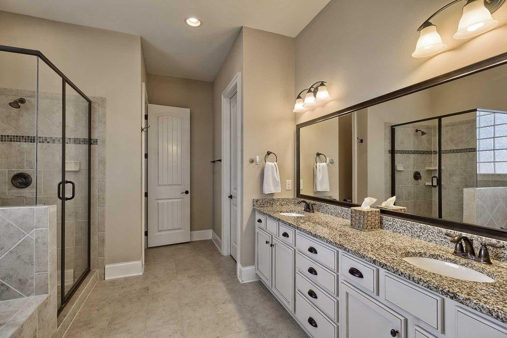Traditional Master Bathroom with New Caledonia Granite Countertop, Arizona,  MS International Ramon Grey Limestone