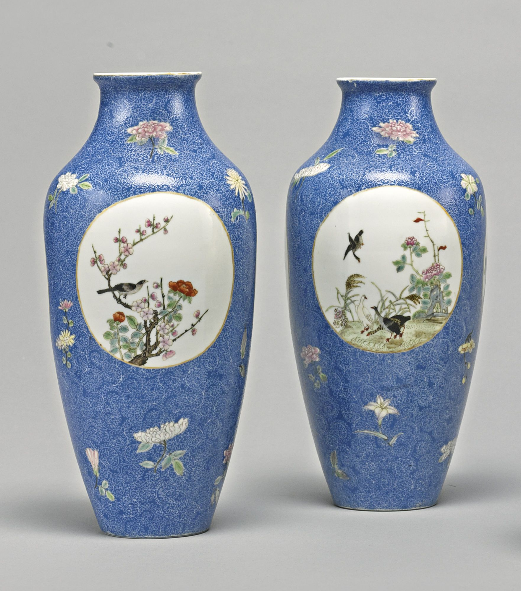 A pair of blue ground famille rose vases republican period each of a pair of blue ground famille rose vases republican period each of tapering ovoid form rising to a flared mouth and recessed foot decorated in bright reviewsmspy
