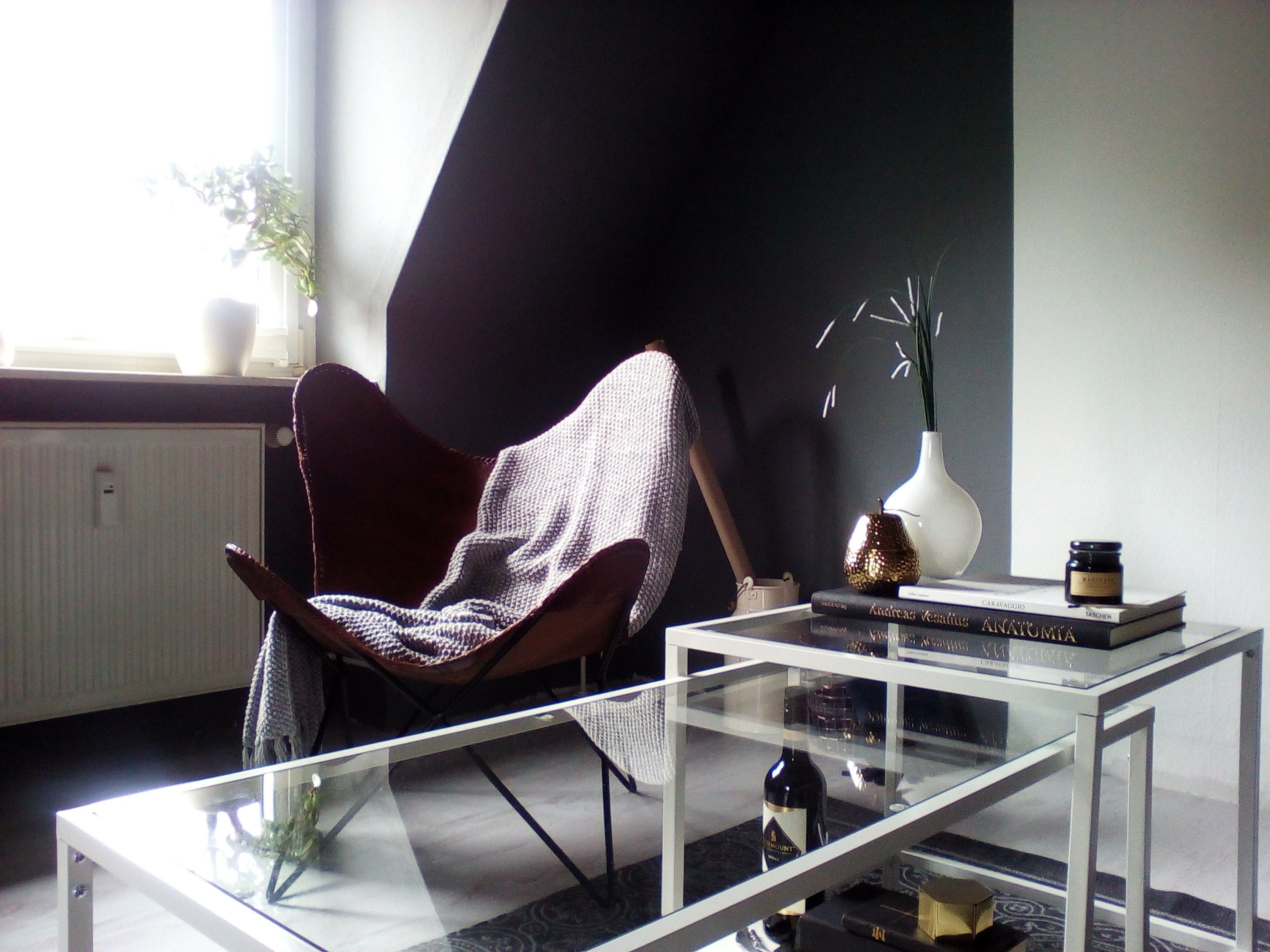 Butterfly chair in Grey living room with white IKEA vittsjö coffee