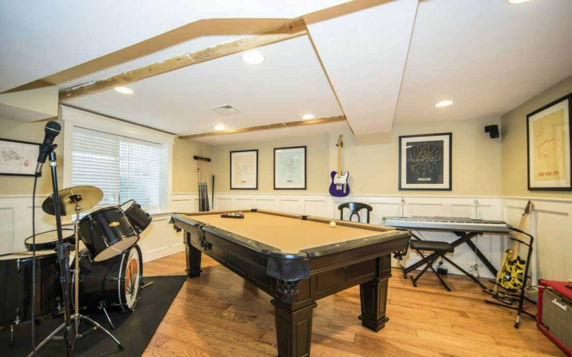 A fully finished basement complete with game room.