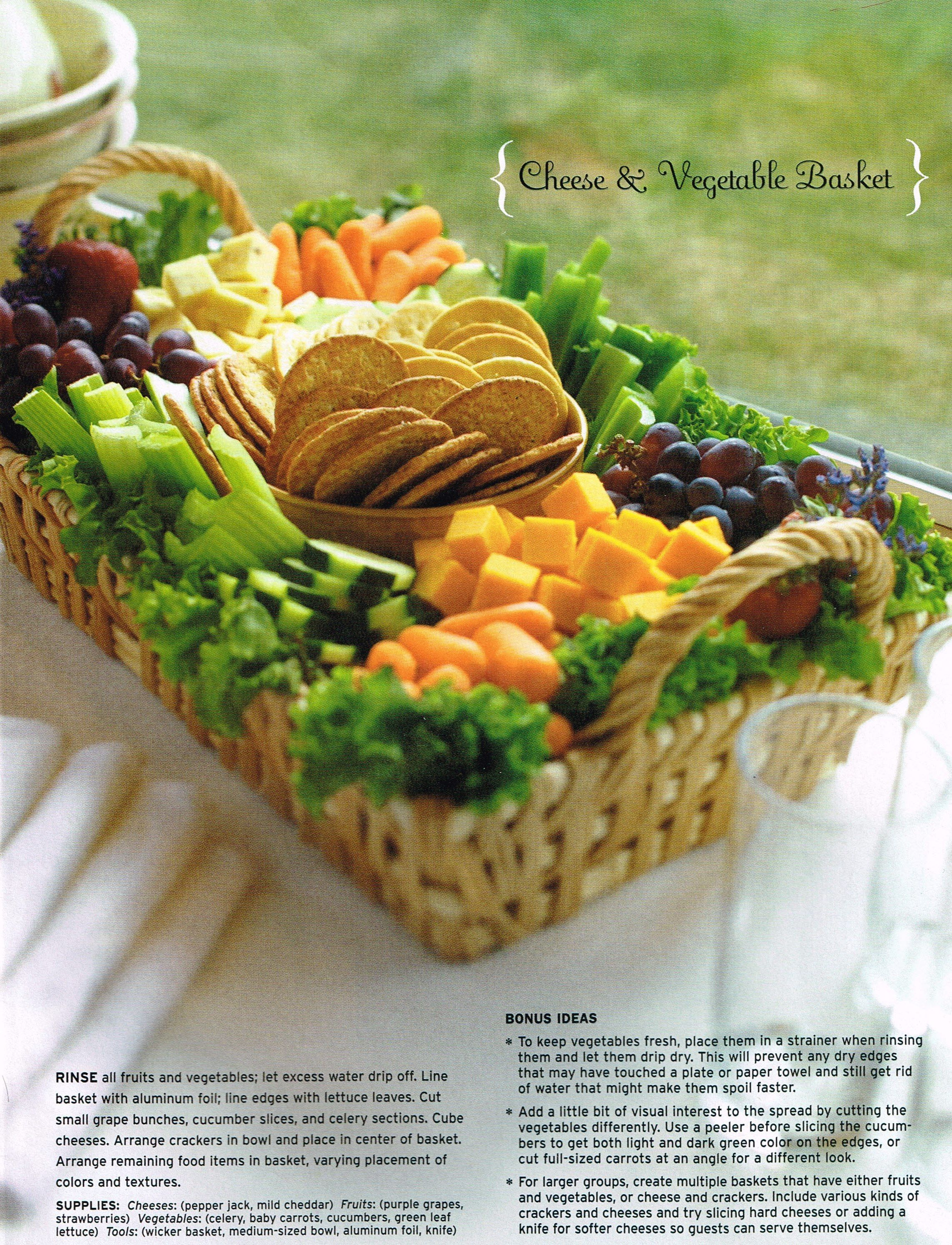 Potluck | Cheese, cracker, fruit, veggie tray..love the basket lined with kale/ curly lettuce