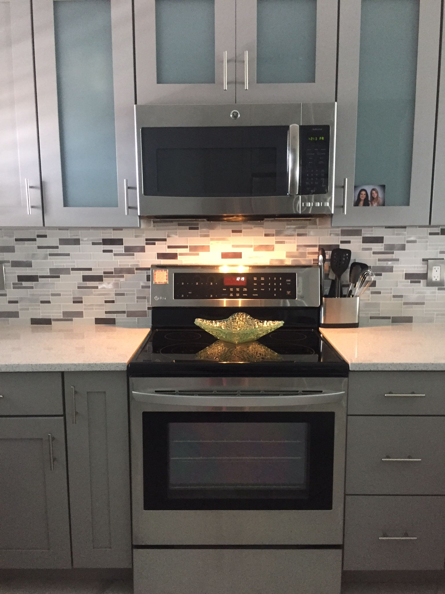 My Sarasota Kitchen! Cabinets: Kraftmaid Pebble Grey With Shaded Glass  Inserts Counters : Cambria, Whitney... So Sparkly Backsplash: Chromes,  Grey, ...