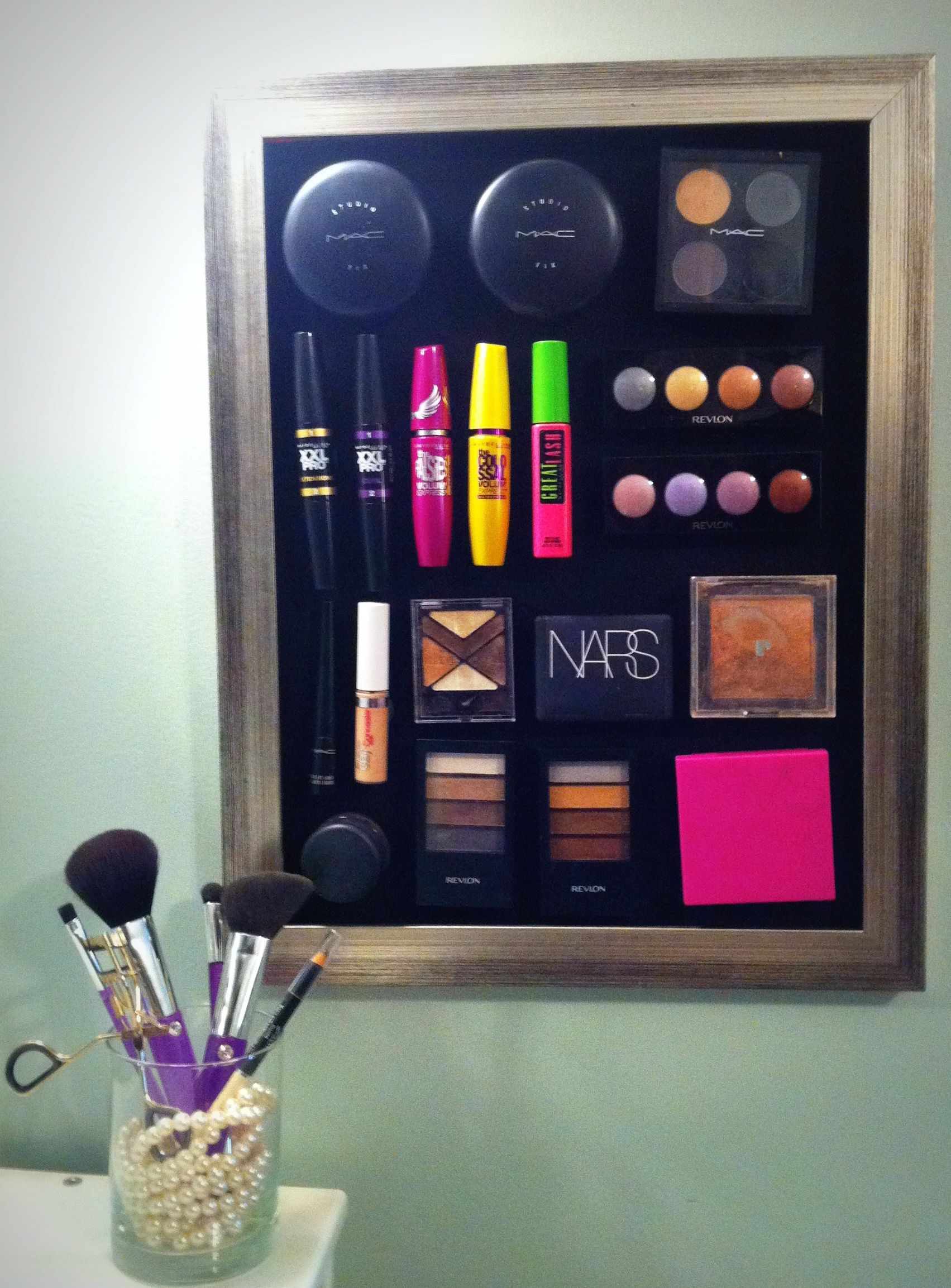 Magnetic Make-up board. Cover a sheet of metal with fabric and glue to a frame. Add small magnets to the back of your make-up products and enjoy!